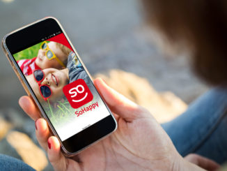 close-up view of young woman holding a smartphone with mobile rates comparator on screen. All screen graphics are made up.